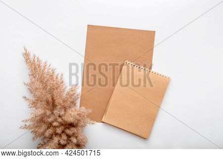 Earthy Beige Color Blank Craft Paper Card Note Invitation Mockup With Dry Bloom Reed Pampas Branch.
