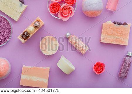 Handmade Pink Colorful Soap Spa Bath Products Pattern On Purple Background. Bomb Beads Bath Powder.