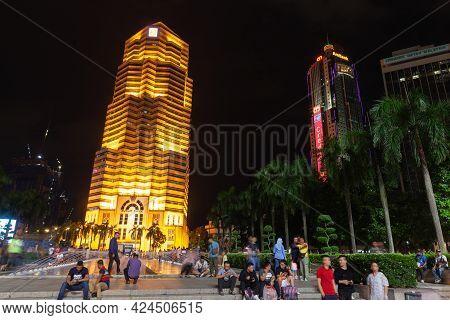 Kuala Lumpur, Malaysia - November 28, 2019: Night Street View Of Kuala Lumpur Downtown With The Publ