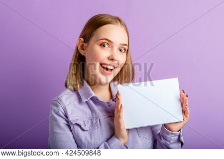 Emotional Portrait Of Happy Young Woman Show Empty Mockup White Card. Happy Smiling Woman Celebratin
