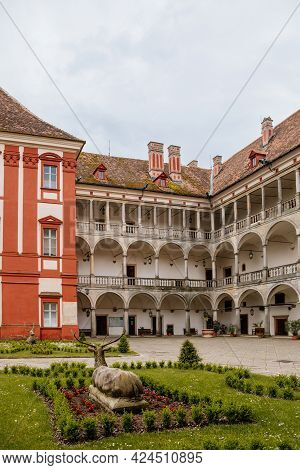 Opocno Castle, Renaissance Chateau, Courtyard With Arcades And Red Facade, Green Lawn With Statue An