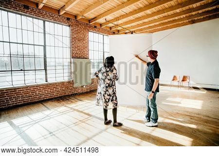 People planning a project for indoor empty space
