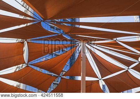 Creative Outdoor Canopy Construction Of Dark Orange Colored Fabric Triangle Awnings From The Sun Aga