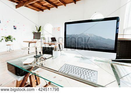 Computer on a glass table mockup