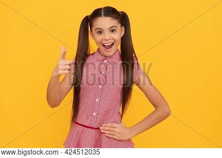 Happy Girl Child Point Finger Gun Hand Gesture Yellow Background, Pointing