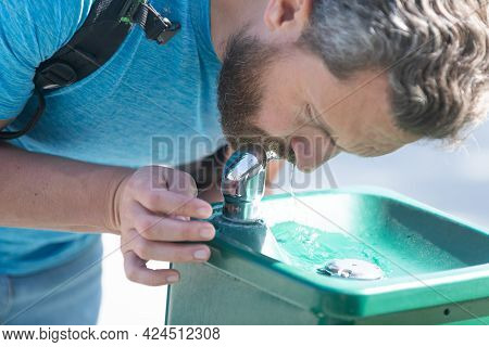 Thirsty Guy Drink Water From Drinking Fountain Quenching Thirst, Hydration