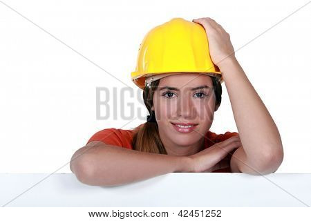 A portrait of a female construction worker.