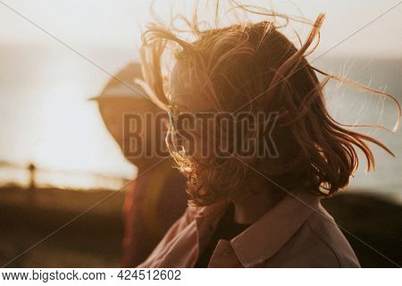 Woman strolling around with her friend in harsh winds