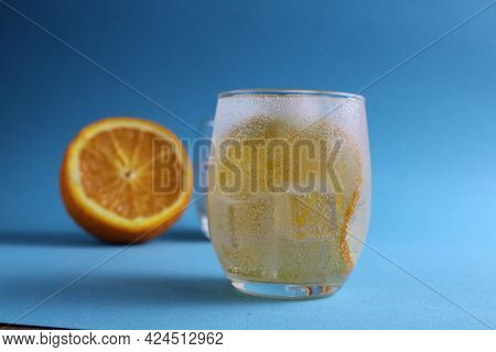 Step-by-step Making Of Lemonade. Step 2. Pour The Fruit Orange With Soda Water. A Glass Of Lemonade