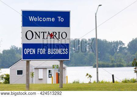 Hawkesbury, Ontario, Canada - June 21, 2021: A Sign On Ile De Chenail Welcomes Motorists Crossing Fr