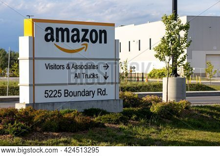 Ottawa, Ontario, Canada - June 21, 2021: A Branded Sign At The Amazon Distribution Warehouse At 5225