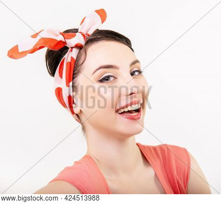 Smiling girl, retro portrait of young cheerful woman in pin-up style, vintage stylization, studio shot over white background.