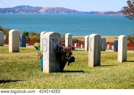 June 8, 2021 In San Francisco, Ca:  Rows Of Headstones On Grave Sites At The National Cemetery Withi
