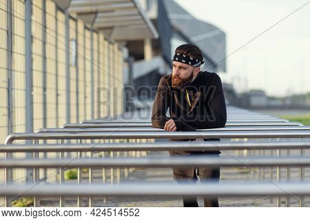 Fit Man Doing Triceps Dips On Parallel Bars At Park Exercising Outdoors