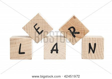 Learn Written With Wooden Blocks.