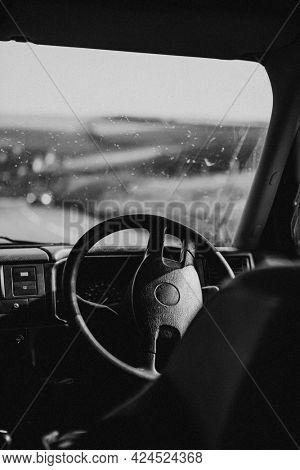Interior car steering wheel parked by the road