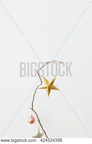 Festive golden star on a branch