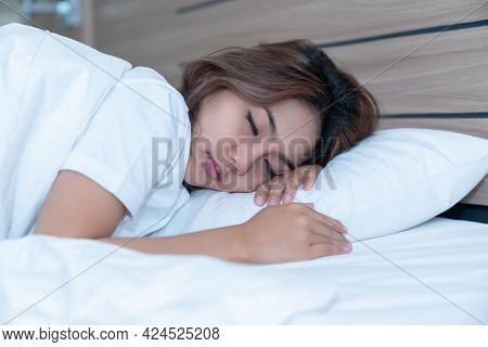 Young Woman Sleeping Cozily