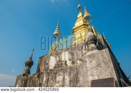 The Gilded Stupa Of Wat Chom Si On The Summit Of Mount Phu Si The Sacred Mountain In The Centre Of L