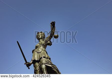 Lady Justice With Sword And Scale Symbolizes Justice