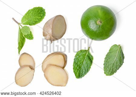 Isolated Sliced Ginger And Lime. Flat Lay Fresh Sliced Ginger Rhizome With Lime And Green Mint Leave