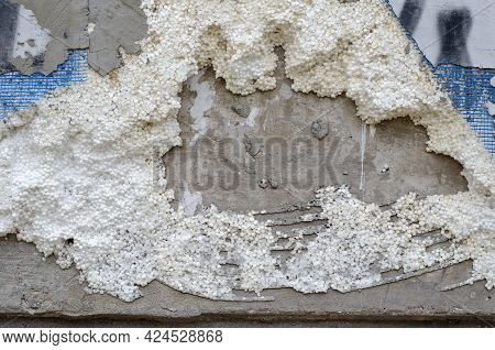 Destroyed Insulation Of The Outer Wall Of The Building. Damaged By Vandals Multilayer Sound-thermal
