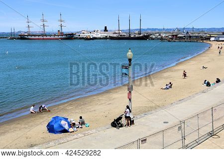 June 8, 2021 In San Francisco, Ca:  Pathway Besides A Sandy Beach Cove With The Historical Hyde Stre