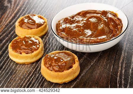 Sandwiches From Soft Biscuit Waffles With Boiled Condensed Milk, White Bowl With Boiled Condensed Mi
