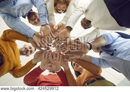 Diverse Multiethnic People Group Holding Hands Together View From Bottom