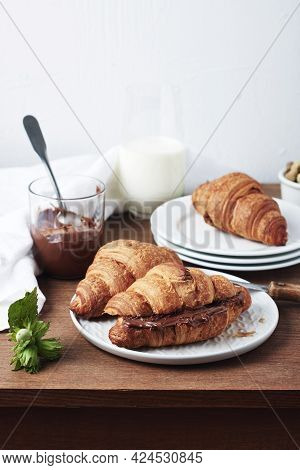 Freshly Baked Croissants With Chocolate Cream And Hazelnuts.