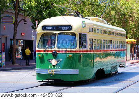 June 7, 2021 In San Francisco, Ca:  Vintage Street Car Riding On Market Street Towards Fishermans Wh
