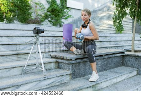 Sport Blog. Attractive Young Sports Woman Working Out With Dumbbells Outdoor, Demonstrating Exercise