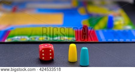 Dice For Board Games On Black Background. Board Game With Multi-colored Cubes On Table Game. Stay Ho