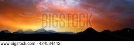 Mountain range silhouette panorama red sky