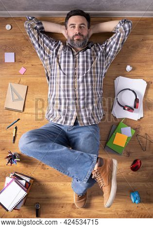 Man relaxing on floor thinking idea solitions. Man lying or student studying online lesson. Creative inspiration study concept