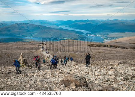 Ben Nevis, Uk - August 24 2019: People Hike On Ben Nevis. Fort William (and Some Other Scottish Vill