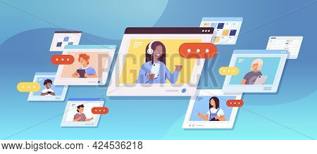 Schoolchildren Using Digital Gadgets Mix Race Pupils Discussing In Web Browser Windows Self Isolatio