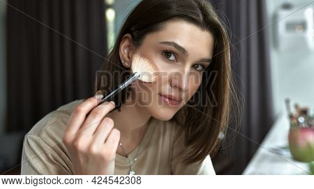Portrait Of A Young Woman Making An Online Tutorial And Showing Her Favorite Organic Beauty Product.