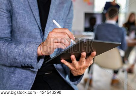 Businessman using a digital tablet in an office