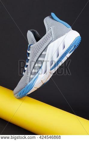 Stability And Cushion Running Shoes. New Unbranded Running Sneaker Or Trainer With Yellow Paper Tube