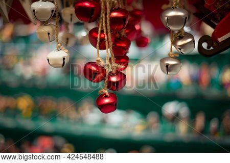 Red And Silver Christmas Bells At A Christmas Market