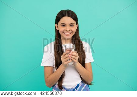 Happy Kid Going To Drink Glass Of Water To Stay Hydrated And Keep Daily Water Balance, Thirst.