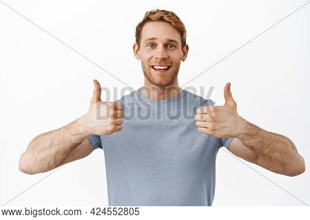 Very Good. Smiling Handsome Redhead Man Showing Thumbs Up In Approval, Like And Agree, Praise And Re