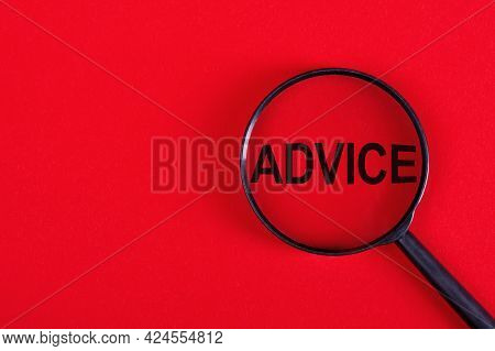 Magnifier With The Word - Advice, On A Red Background.