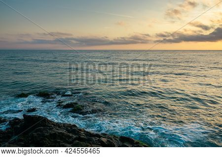 Landscape At The Sea. Beautiful Nature Background In Autumn At Sunrise. Clouds On The Sky Above Hori