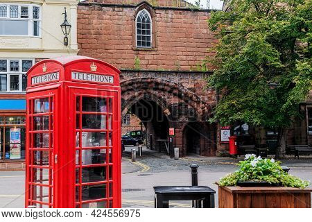 Chester, Great Britain - September 14, 2014: This Is A Red Telephone Booth At The Archway To Old Tow