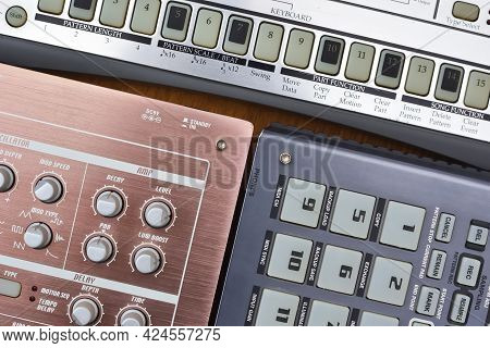 Top View Of Analog Electronic Musical Instruments With Many Buttons And Knobs For Making And Composi