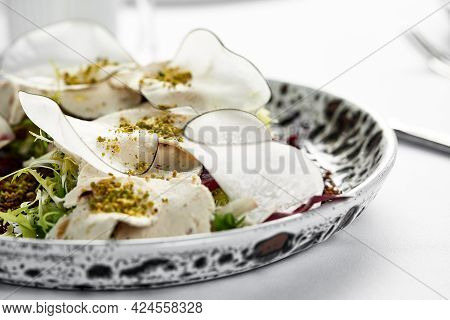 Traditional Italian Appetizer Vitello Tonnato Of Thinly Sliced Marinated Veal, Seasoned With Cream S