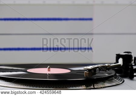 The Process Of Digitizing Vinyl Records Using A Turntable And A Computer. Vinyl Record And Turntable