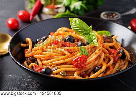 Spaghetti Alla Puttanesca - Italian Pasta Dish With Tomatoes, Black Olives, Capers, Anchovies And Ba